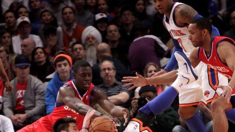New York Knicks' Jeremy Lin, bottom, fights for