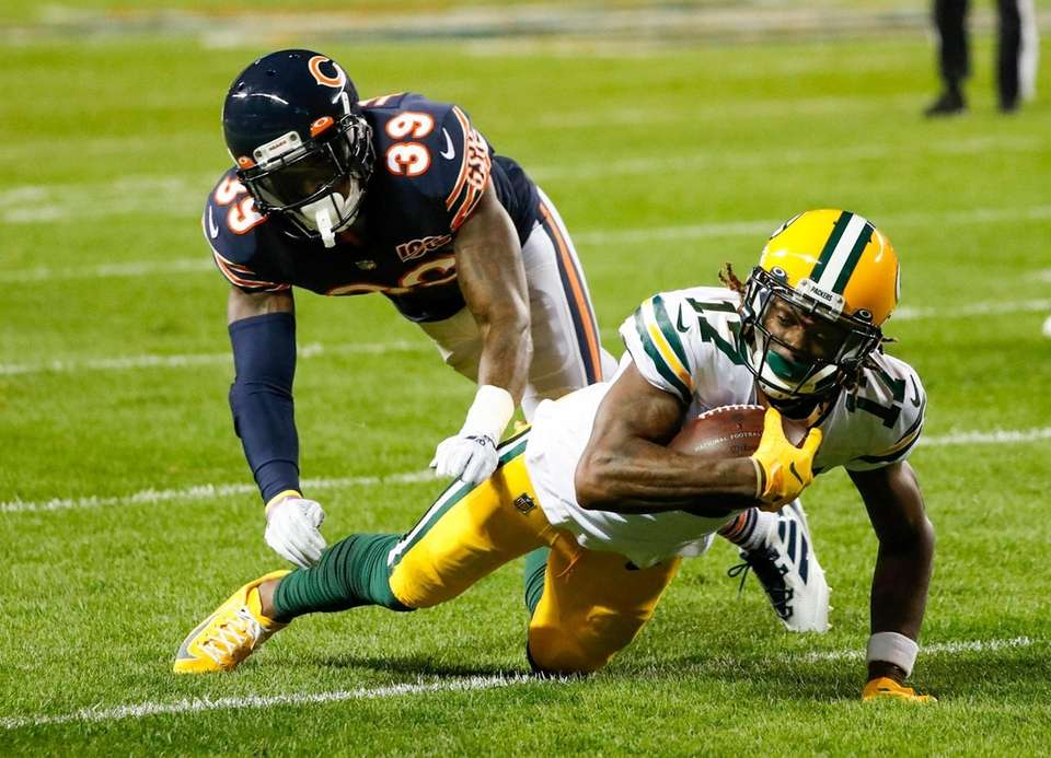 Green Bay Packers' Davante Adams is stopped by