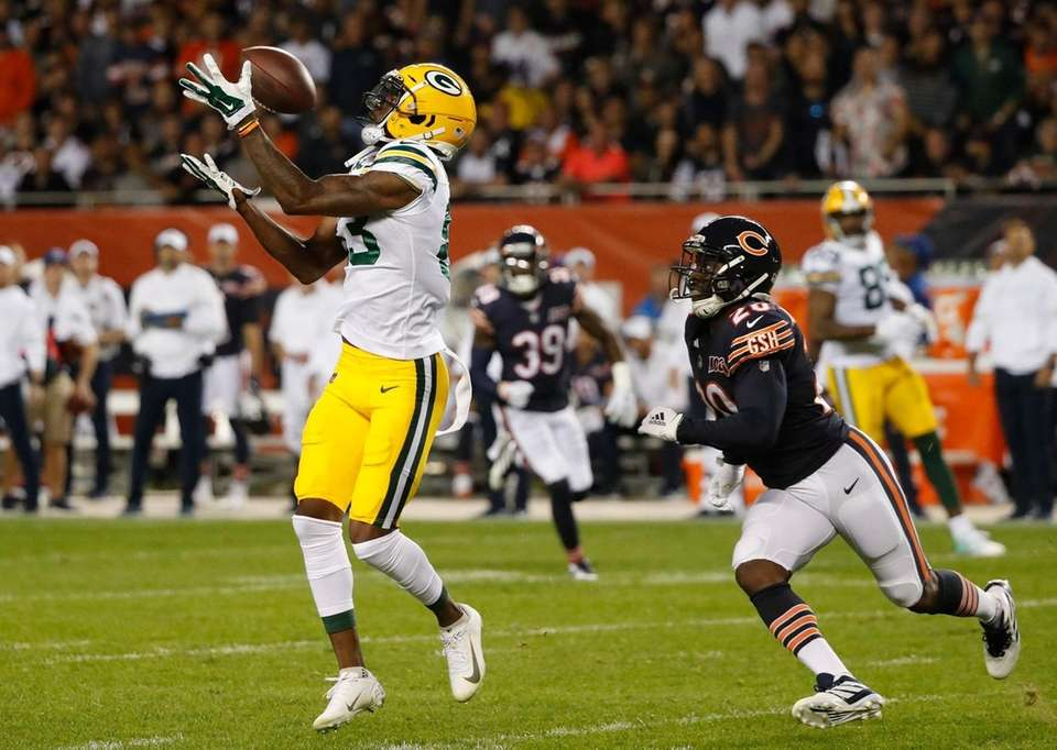 Green Bay Packers' Marquez Valdes-Scantling catches a long