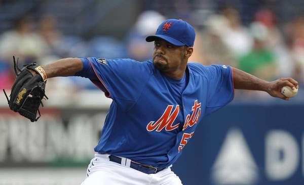Johan Santana throws against the Miami Marlins in