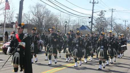 The Tara Pipes & Drums bagpipe group marches