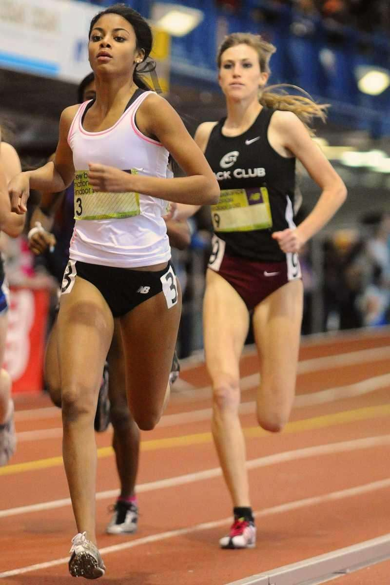 St. Anthony's senior Olicia Williams, left, competes in