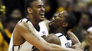 Missouri center Steve Moore and guard Kim English