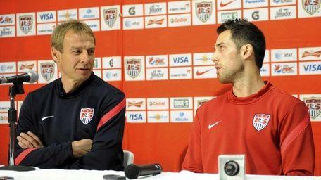 U.S. head coach Jurgen Klinsmann, left, talks with