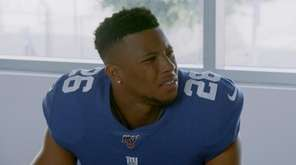 Giants running back Saquon Barkley in a scene