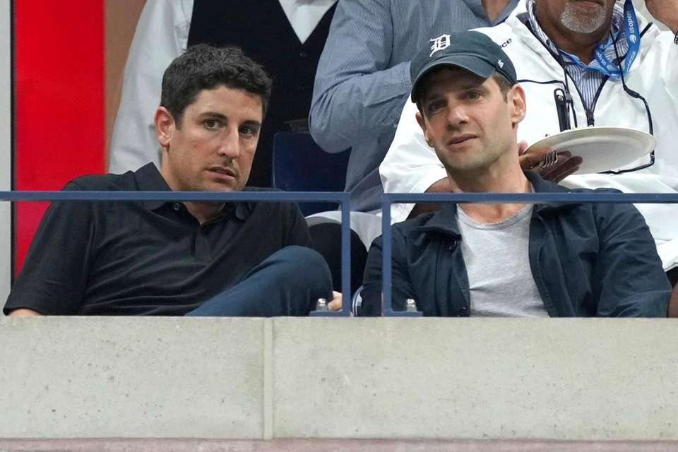 Jason Biggs, left, and Justin Bartha attend the