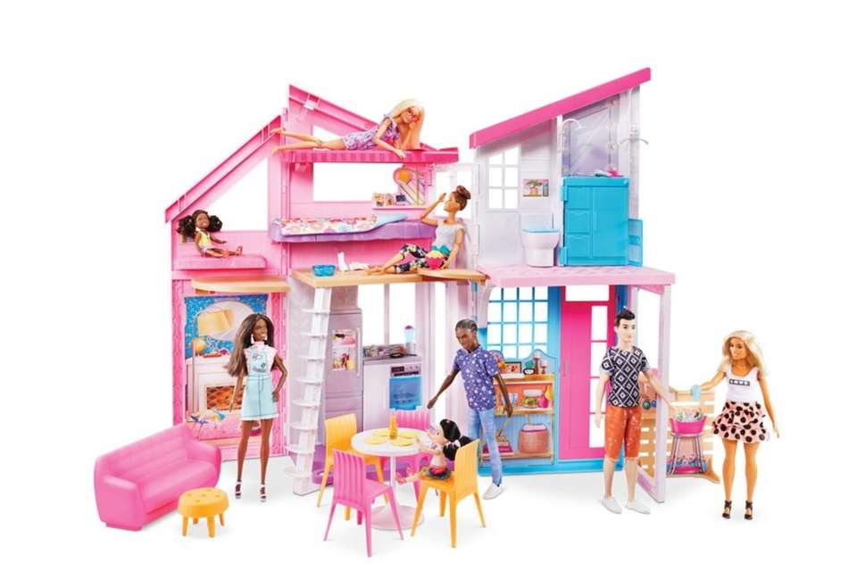 This two-story dollhouse can open more than 2-feet
