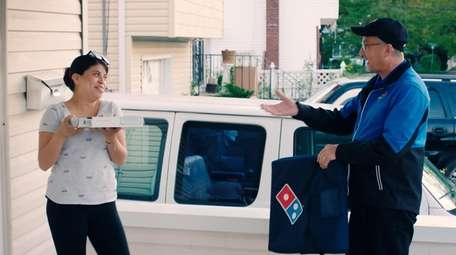 Wyandanch Domino's franchisee John Hall delivers a surprise