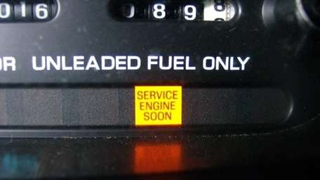 An illuminated service engine light is shown. (Aug.