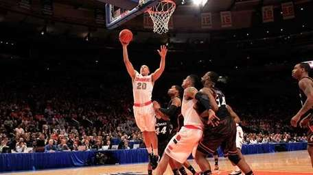 Brandon Triche of the Syracuse drives to the