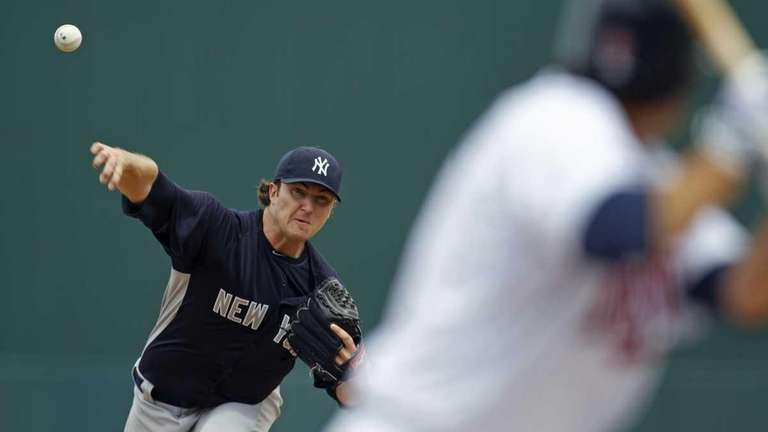 Yankees starter Phil Hughes delivers to Minnesota Twins