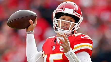 Kansas City Chiefs quarterback Patrick Mahomes passes the