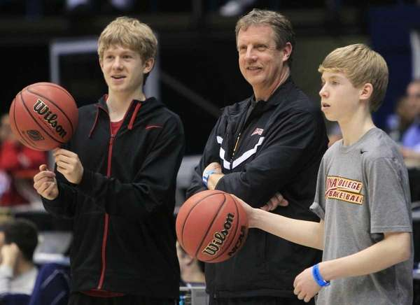 Iona coach Tim Cluess, center, watches practice with