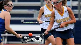 Northport's Kate McLam fights for control of the