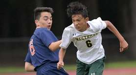 Arvin Pereira of Westbury gets past Logan Golia