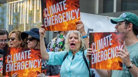 Hundreds of climate activists gathered outside the CNN