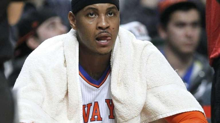 New York Knicks forward Carmelo Anthony sits on