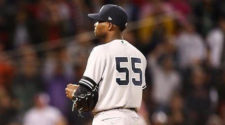Domingo German of the Yankees looks on as