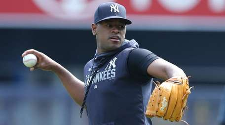 Yankees pitcher Luis Severino throws in the outfield