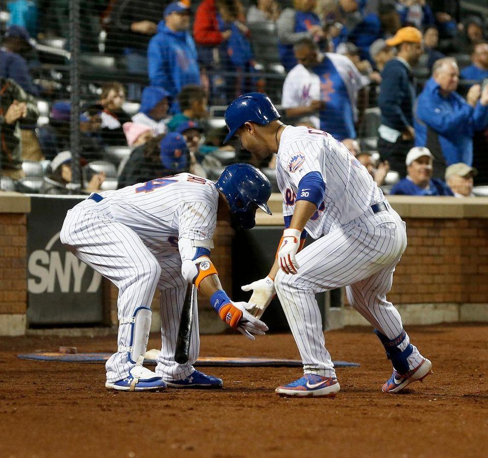 Michael Conforto of the Mets celebrates his fourth