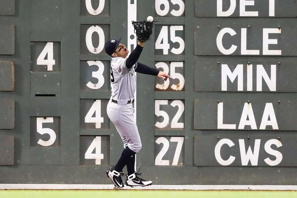 Mike Tauchman of the Yankees misplays a ball