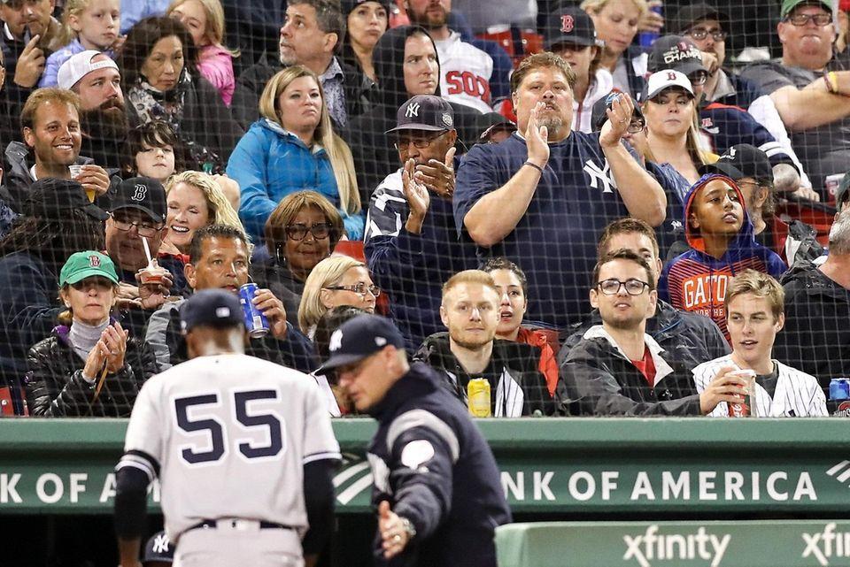 Fans cheer as Domingo German of the Yankees