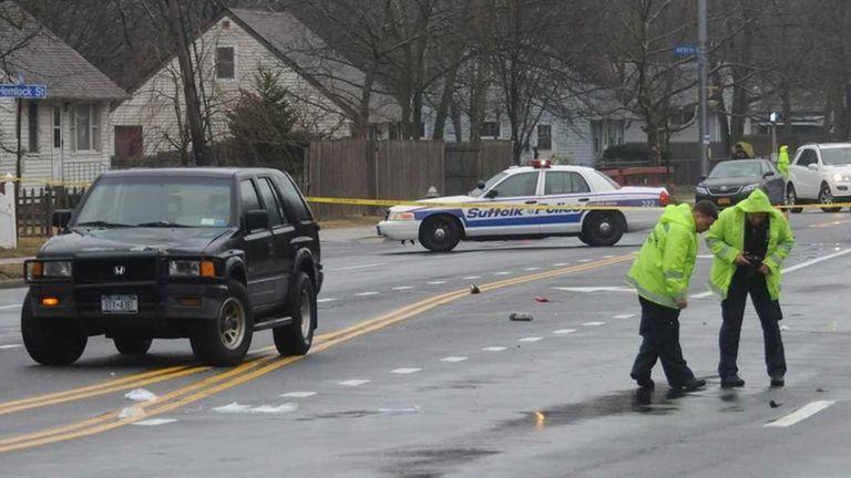 Crime Scene investigators probe the scene where a