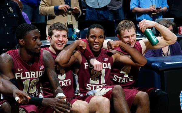 From left, Okaro White, Luke Loucks, Michael Snaer