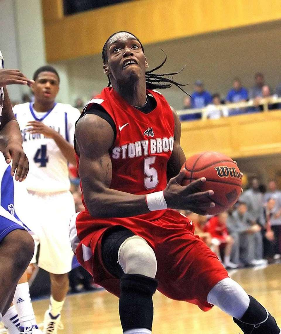 Stony Brook's Dave Coley gets under for a