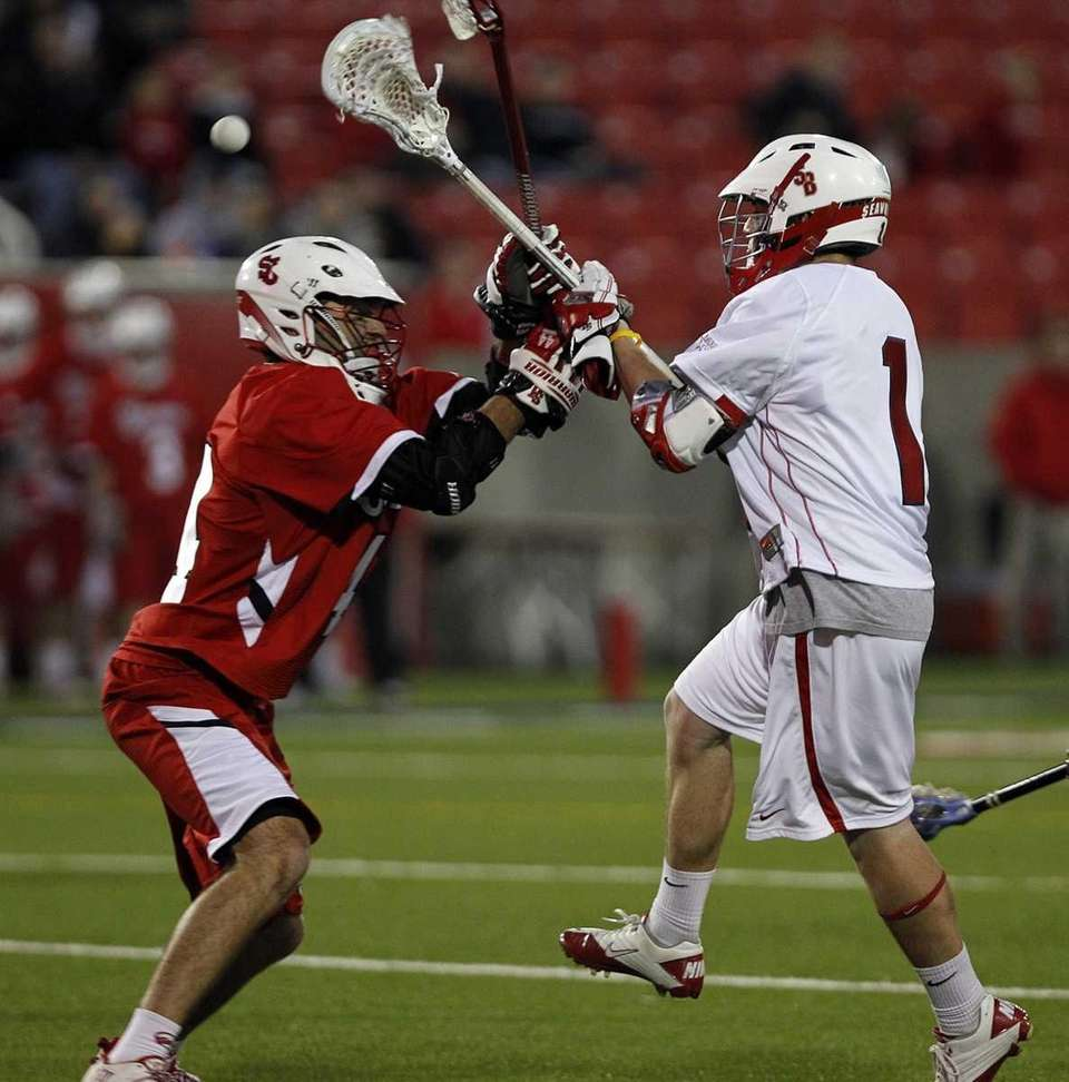 Stony Brook's Mike Rooney shoots over St. John's