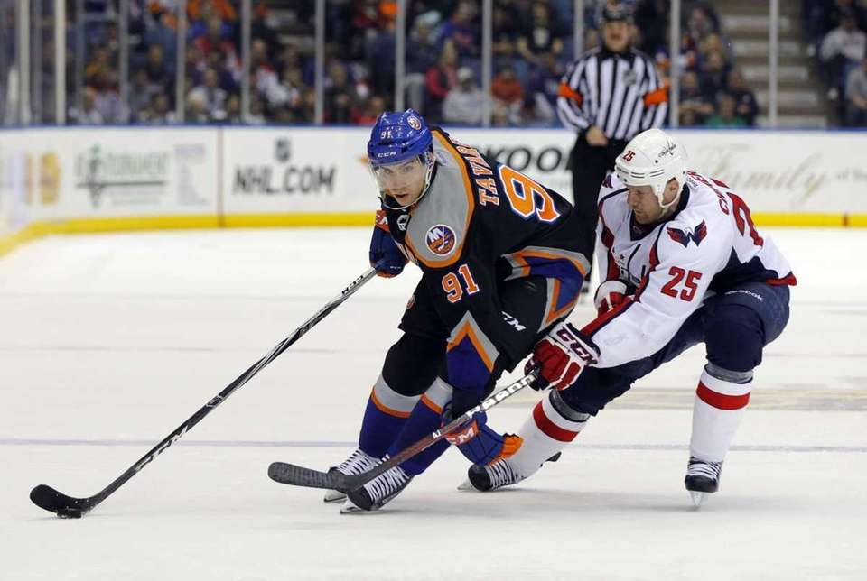 John Tavares of the Islanders controls the puck