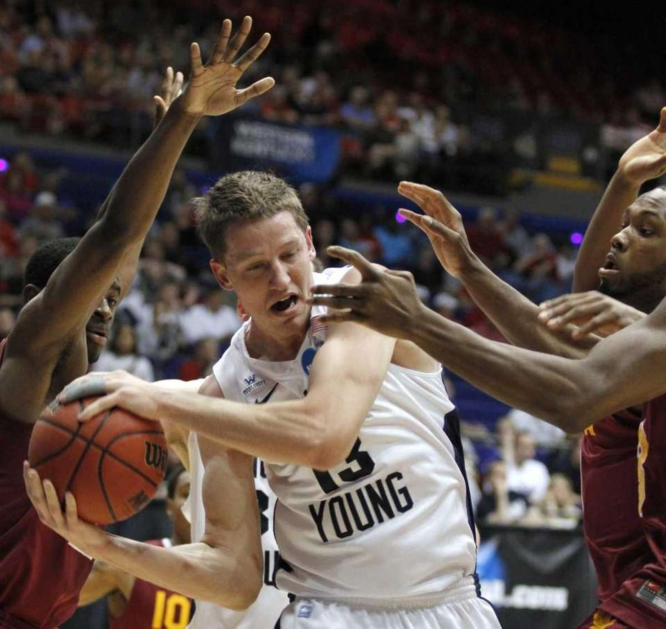 Brigham Young forward Brock Zylstra (13) pulls in