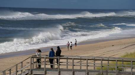 People visit the beach in Montauk on Saturday