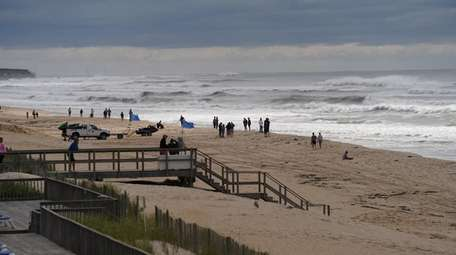 People visit the beach in Montauk to see