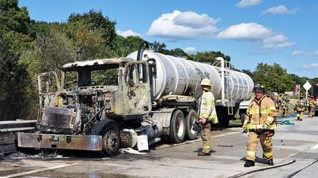Firefighters on the scene of a tanker truck