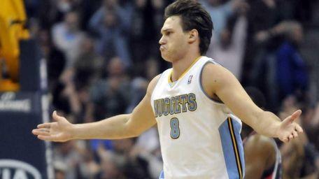 Denver Nuggets' Danilo Gallinari reacts to making a