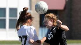 Shoreham-Wading River's Sara Hobbes (27) battles Kings Park's