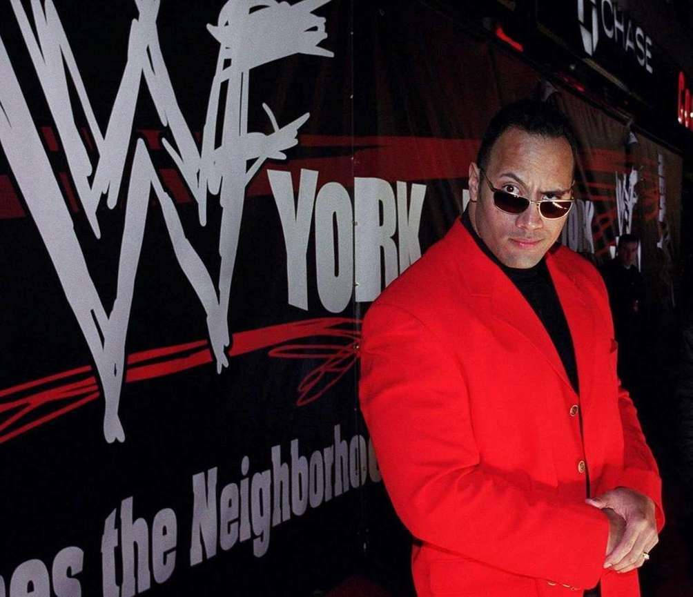 In an undated photo, The Rock stands outside