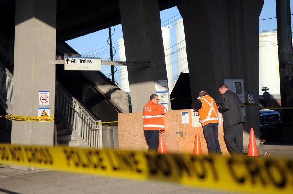 MTA officials look over an escalator at the