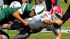 St. John the Baptist quarterback Nicholas Mazziotti dives