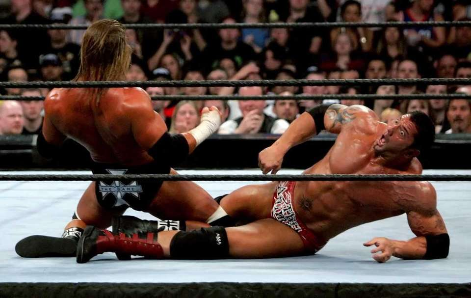 Batista, right,battles Triple H in their bout during