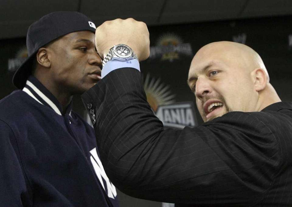 Floyd Mayweather, left, faces off with Big Show