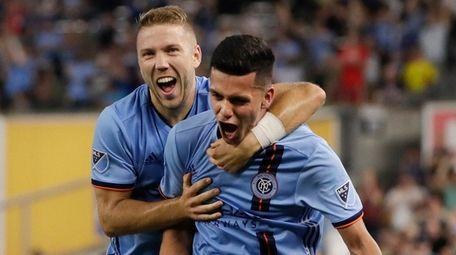 New York City FC's Anton Tinnerholm, left, celebrates