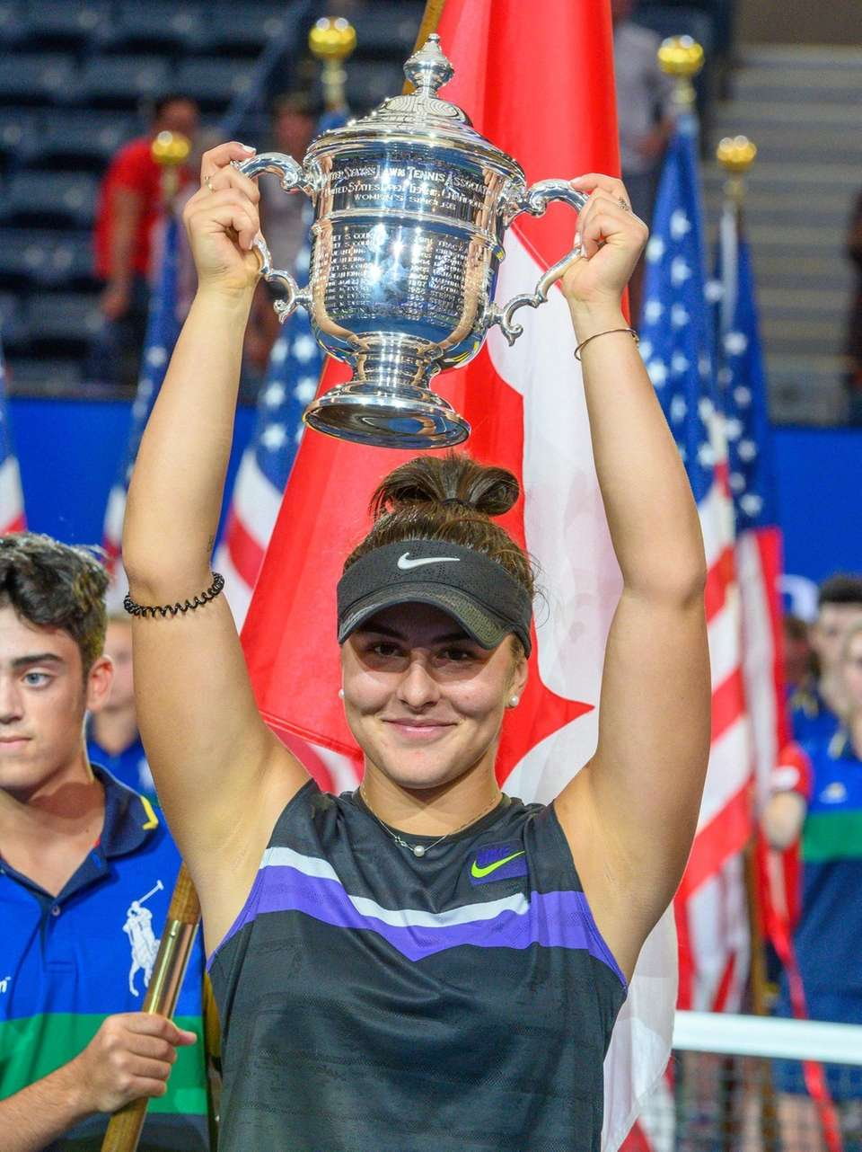 Bianca Andreescu of Canada holding the championship trophy