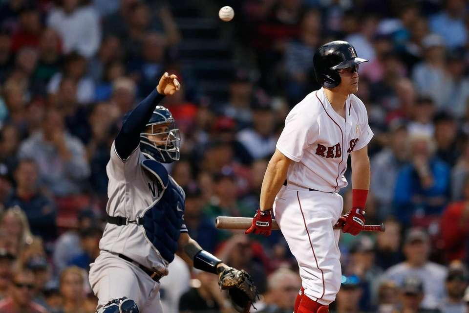 The Red Sox's Brock Holt reacts in front