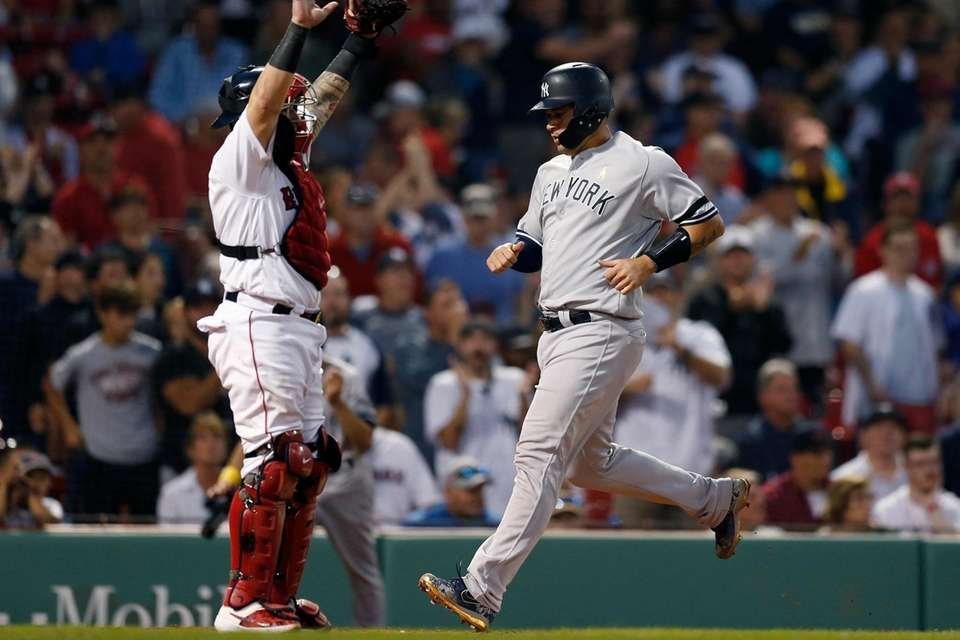 The Yankees' Gary Sanchez, right, scores in front