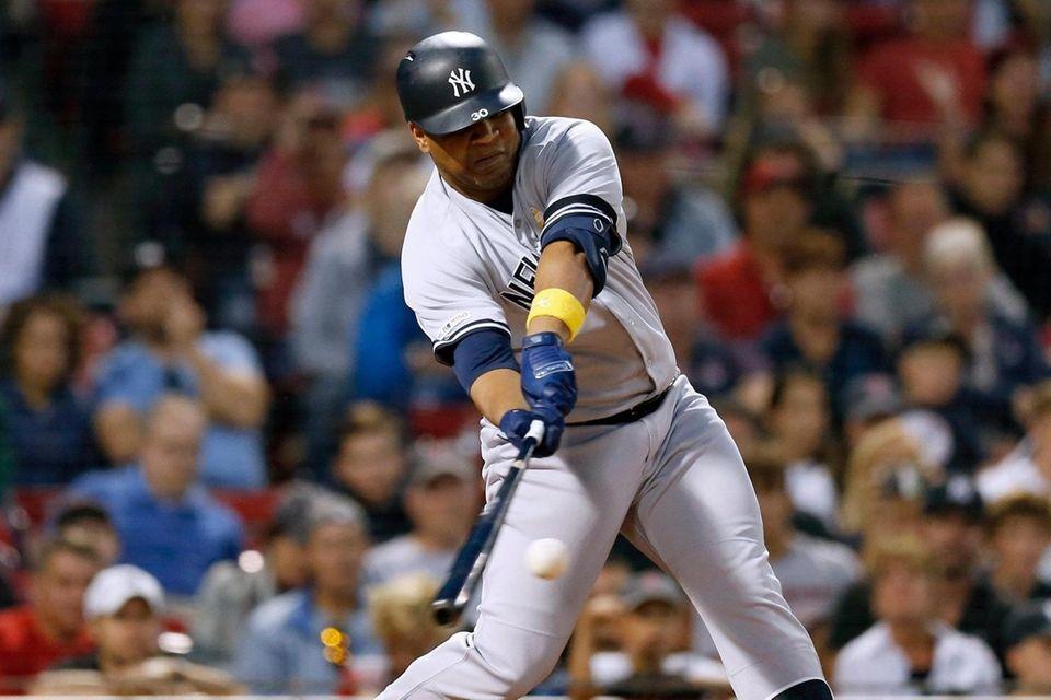 The Yankees' Edwin Encarnacion hits an RBI double