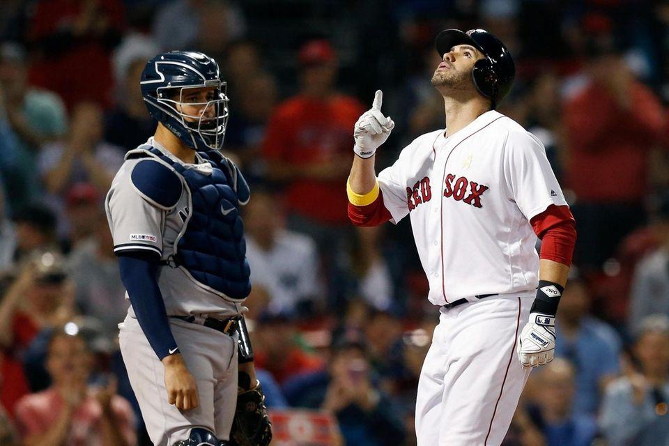Thr Red Sox's J.D. Martinez, right, celebrates his
