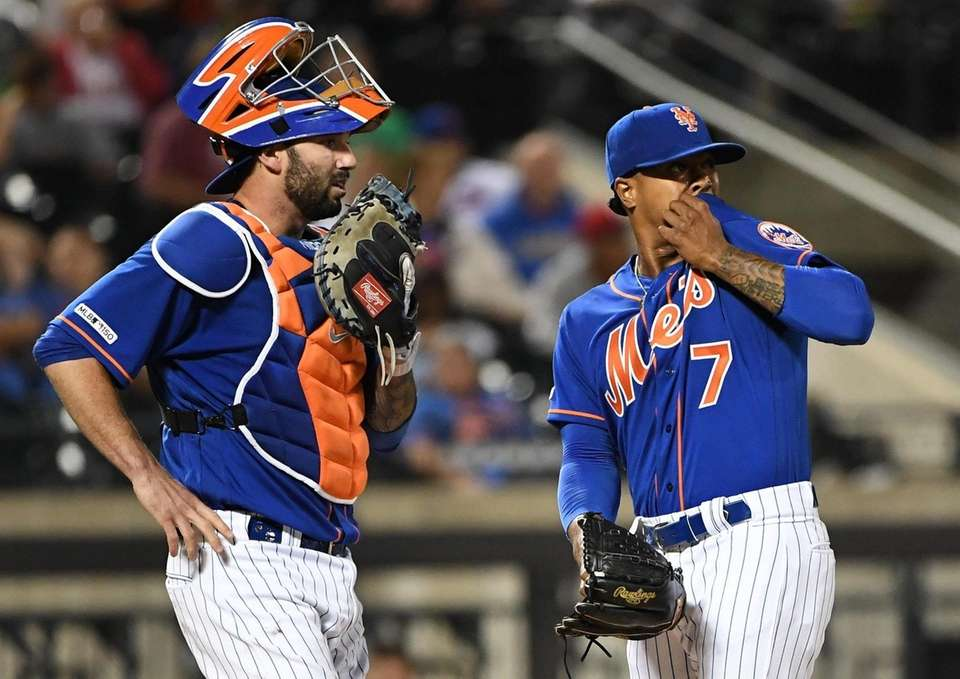 New York Mets catcher Tomas Nido talks with