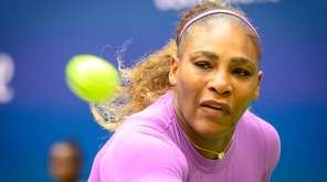 Serena Williams returns the ball to Bianca Andreescu